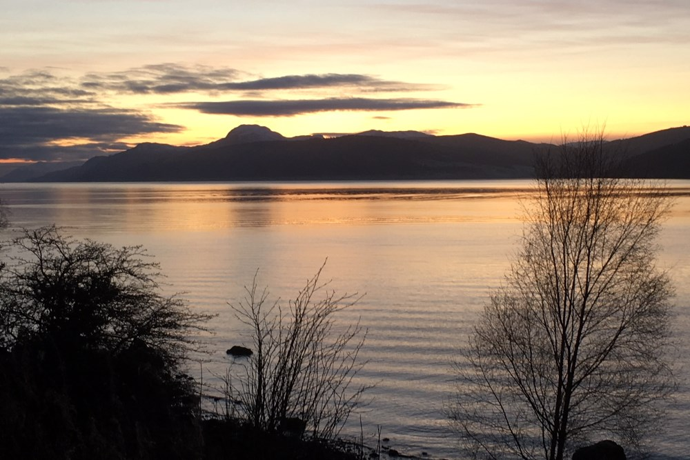 View of Loch Ness sunset from Dores beach near Inverness