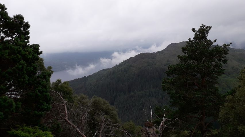 View of Loch Ness with clouds and mist in the Scottish Highlands