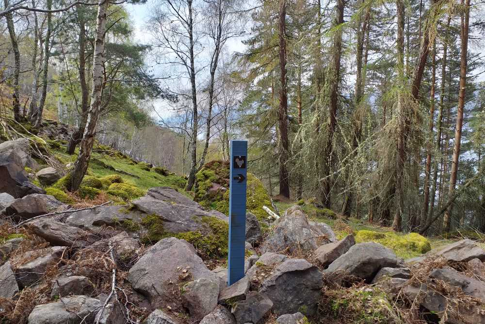 Waymarker on the South Loch Ness Trail with Loch Ness in the background