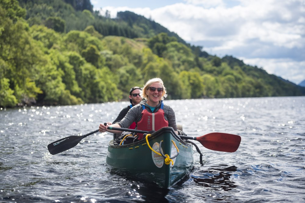 Two people canoeing on Loch Ness with In Your Element
