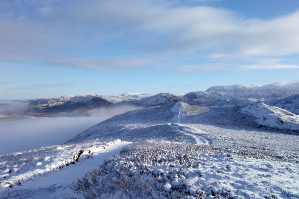 View of the hills around Stratherrick from South Loch Ness Trail viewpoint in winter