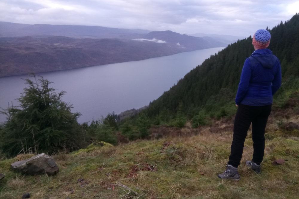 Walker looking over Loch Ness from the Great Glen Way near Drumnadrochit