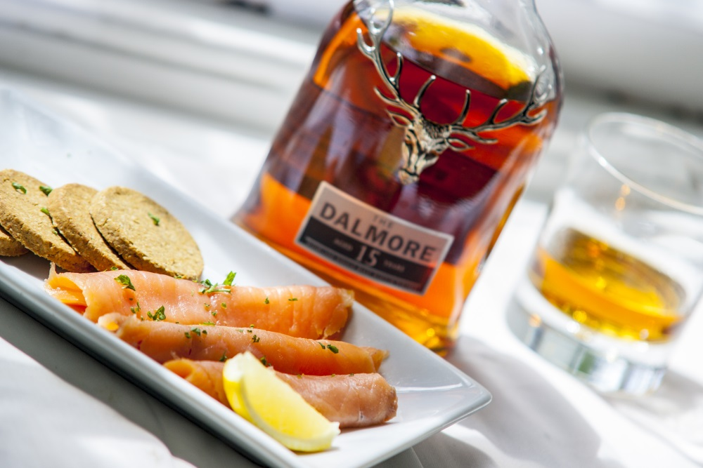 A plate of food and a bottle of whisky at the Glenmoriston Arms Hotel