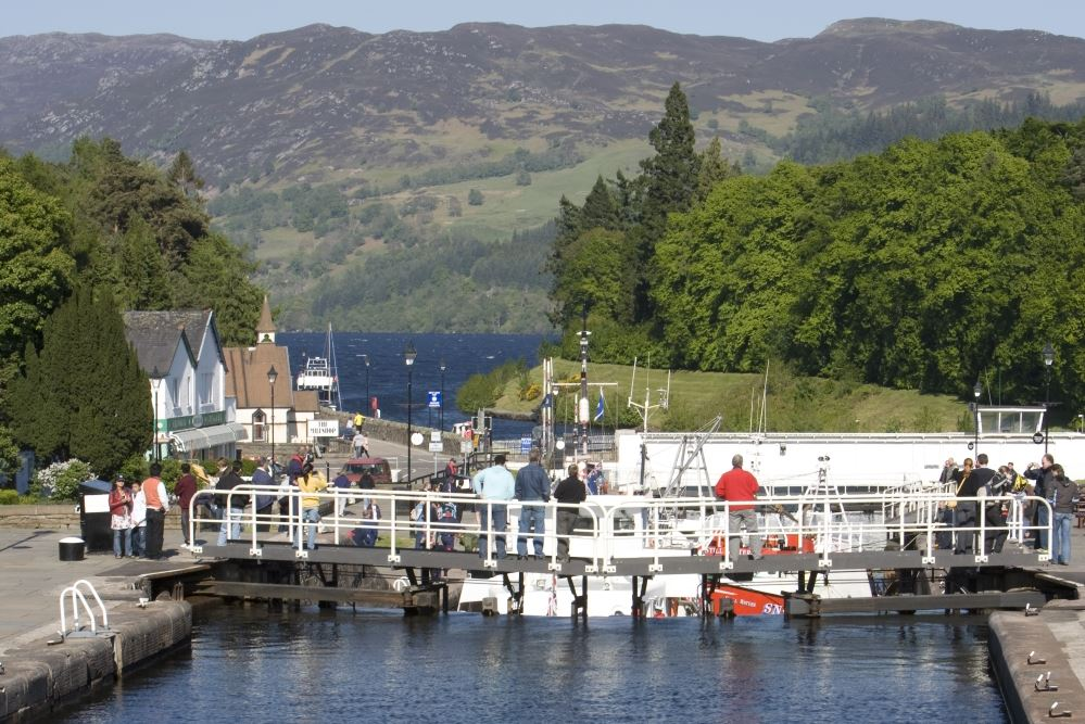 People standing on a Caledonian Canal key at Fort Augustus