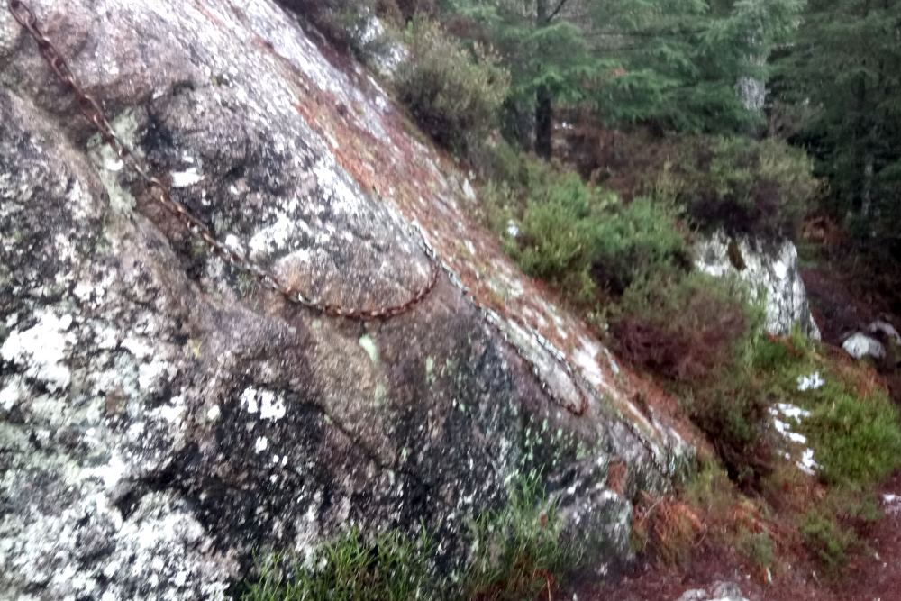 Chains on a rock on the South Loch Ness Trail to help walkers get across a steep section