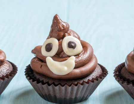 Smiling faeces - cupcakes made to look like poo emojis