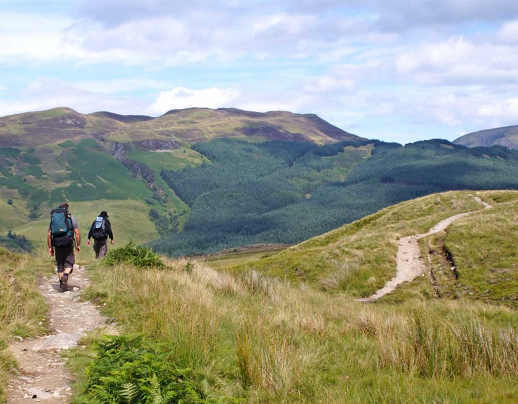 Hikers along the West Highland Way on a sunny day.