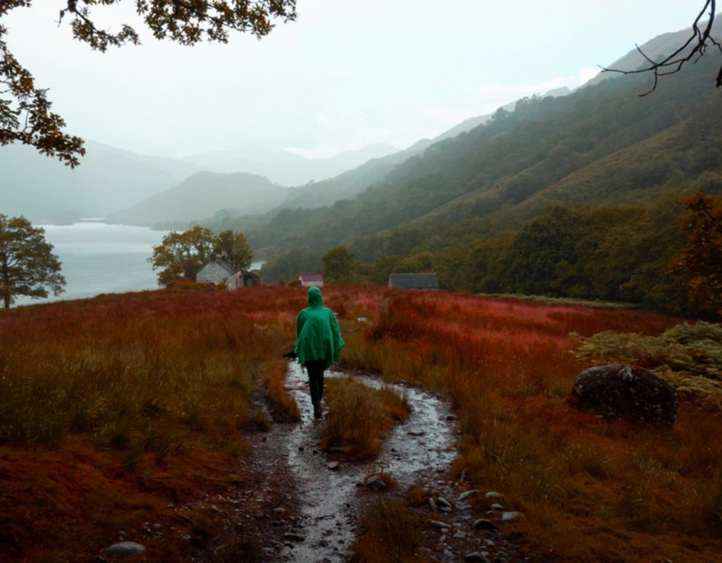 A hiker walking in the rain in the beautiful Scottish Highlands.