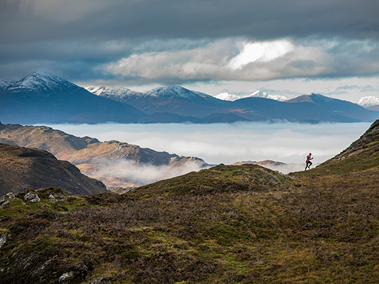 a runner in the hills of Scotland