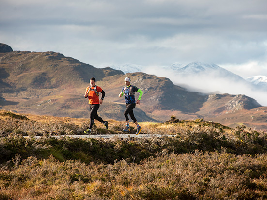 running men in the Highlands of Scotland