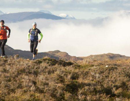 Two men running near Loch Ness