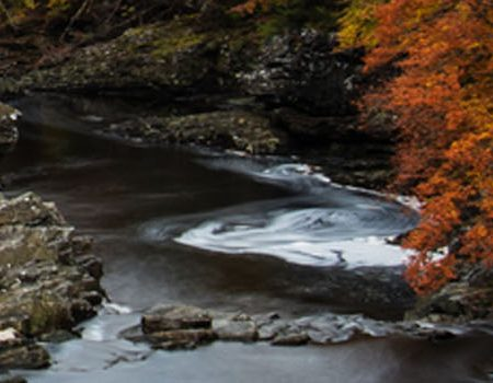 The Great Glen Way with Autumnal colours encompassing a river