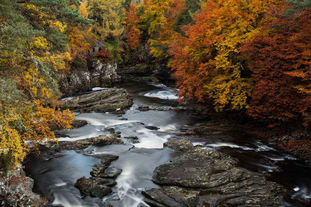 The River Moriston surrounded br Autumnal trees on the Great Glen Way