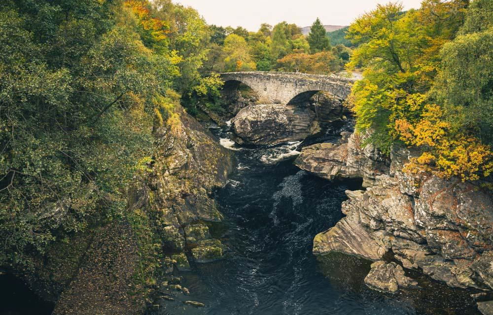 Invermoriston Thomas Telford bridge surrounded by Autumnal tress