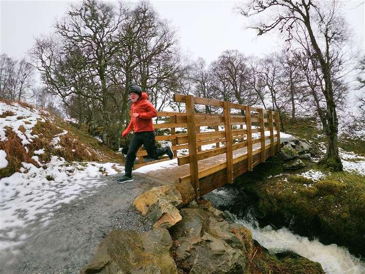 A man running across a bridge