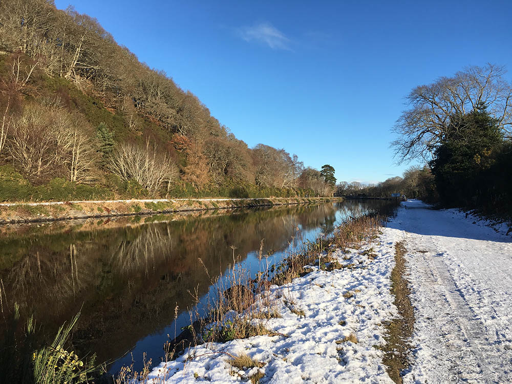 Th Caledonian Canal on a winters day with a snow covered path