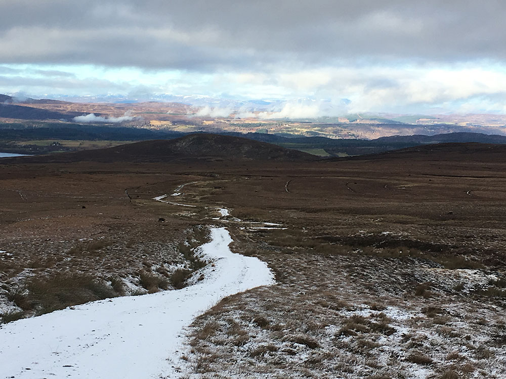 The Loch Ness 360 trail with snow on the path