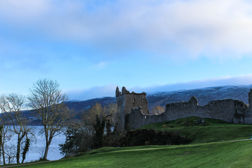 Urquhart Castle with snowy hills in the background