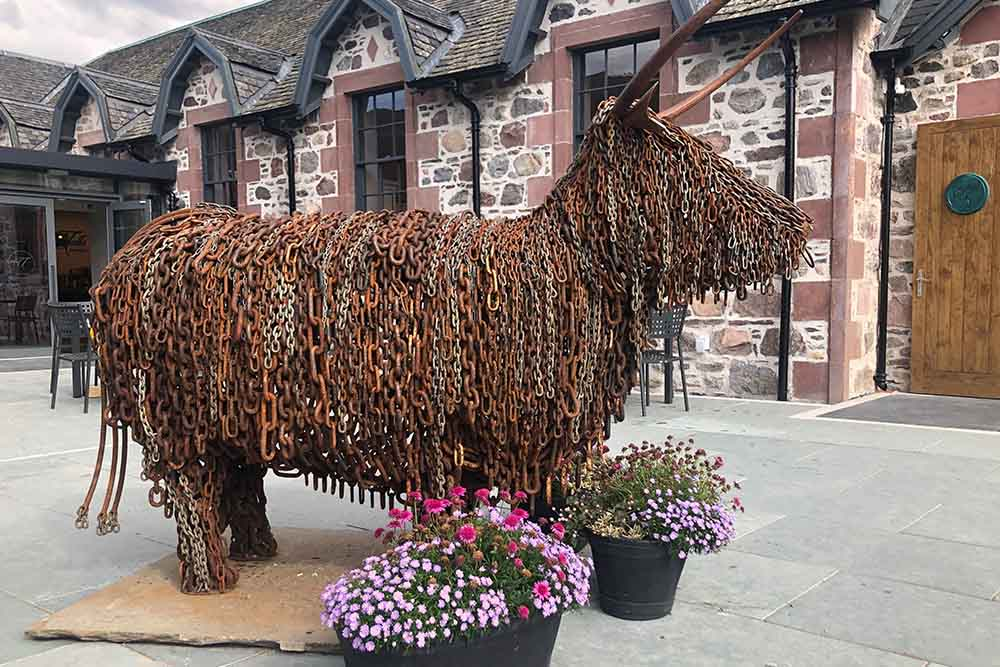A Highland Cow made of chains at An Talla by Loch Ness
