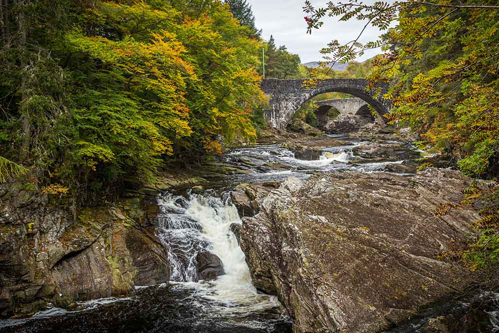 The water flowing under Invermoriston Bridge