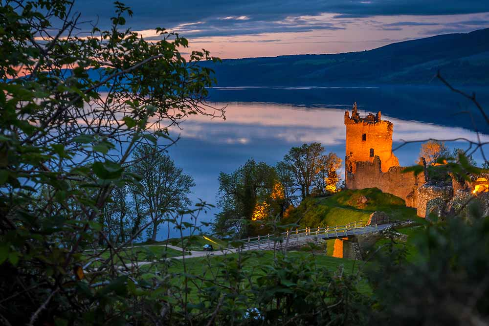 urquhart castle lit up at night